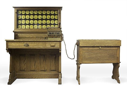 Hollerith Electric Tabulating System   The 60 million cards punched in the 1890 United States census were fed manually into machines like this for processing. The dials counted the number of cards with holes in a particular position. The sorter on the right would be activated by certain hole combinations, allowing detailed statistics to be generated. An average operator could process about 7,000 cards a day.