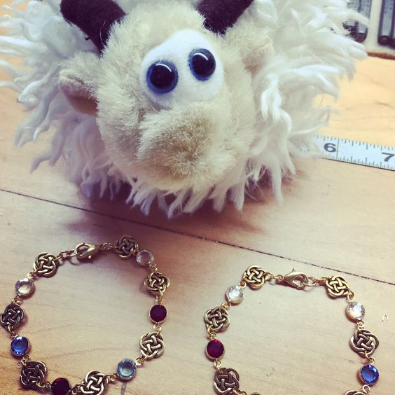 My special helper, Seamus the Sheep all the way from Doolin, Ireland, is inspecting these gold custom birthstone bracelets before they get shipped today. He's making sure Peat Dire Jewelry's standards are high! ☘️