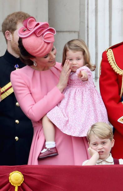 Prince Harry Catherine Duchess of Cambridge Princess Charlotte of Cambridge and Prince George of Cambridge look out from the balcony of Buckingham...