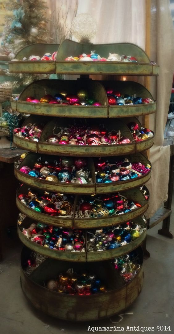 Vintage industrial rotating parts bin used to hold a plethora of vintage Christmas ornaments. Aquamarina Antiques at Sweet Salvage in Phoenix, AZ
