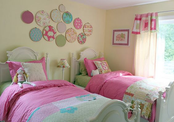 I want this bedroom for my girls! Love the embroidery hoops!