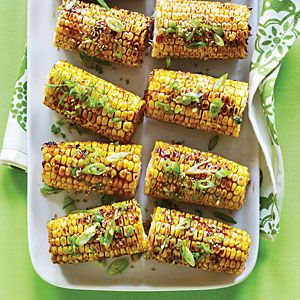 Add Asian flavor to your grilled corn by brushing it with a mixture of hoisin sauce, soy sauce, and sesame seeds.  The spiciness comes from the minced serrano chile pepper.