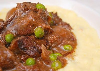 Slow Cooked German Short Ribs  1 teaspoon salt  1/8 teaspoon ground black pepper  3 pounds beef short ribs  2 tablespoons olive oil  1 slice onion, sliced  3/4 cup dry red wine  3 tablespoons packed brown sugar  3 tablespoons vinegar  1 tablespoon Worcestershire sauce  1/2 teaspoon dijon mustard  1/2 teaspoon chili powder  1/2 cup frozen peas