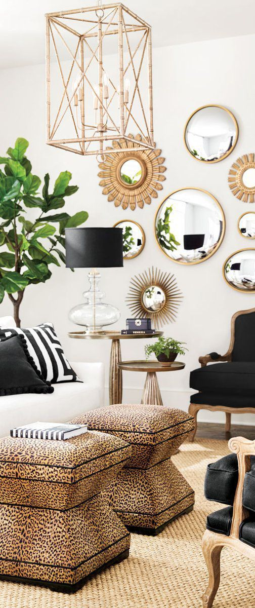An Eclectic Living Room With Leopard Print Bamboo Pendant And Metallic Accents Ballard Designs Living Room Gold Accents Living Room Leopard Print Living Room Animal print living room decorating