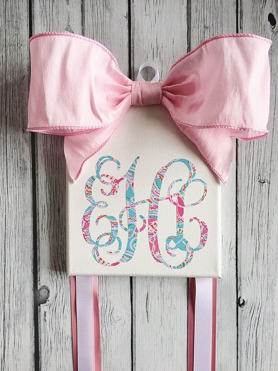 Monogrammed Hair Bow Holder with Lilly Pulitzer inspired vinyl monogram by BellesandBullfrogs on Etsy https://www.etsy.com/listing/248668663/monogrammed-hair-bow-holder-with-lilly: