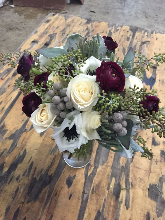 Free formed ivory, grey and burgundy bridal bouquet - Vendela roses, silver brunia berries, burgundy ranunculus, seeded eucalyptus. Designed by Cloud 9 Wedding Flowers, Orlando, FL: