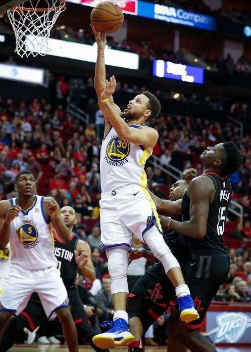 Golden State Warriors Guard Stephen Curry 30 Jumps Past Houston Rockets Center Clint Capela Nba Basketball Game Houston Basketball Basketball T Shirt Designs