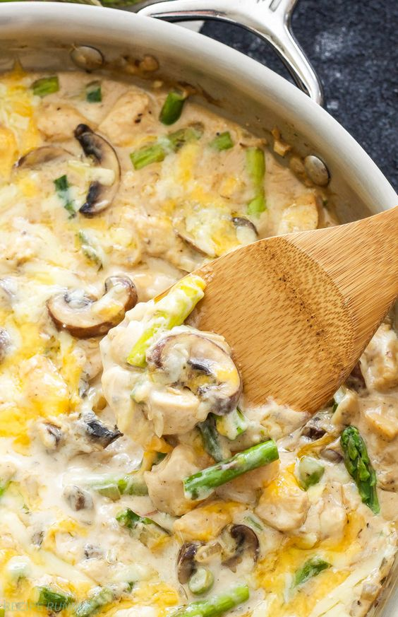 One Pot Creamy Chicken and Asparagus Casserole   An easy one pot, lightened up comfort meal, full of chicken, asparagus, mushrooms and cheese!