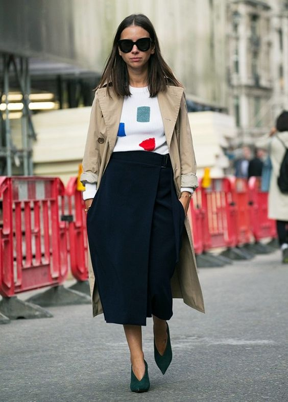 Natasha Goldenberg makes a simple but effective statement in her arty knit with a midi skirt and trench coat.: