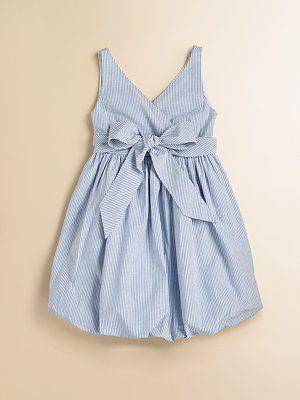 I'm making my Seersucker dress this week if it kills me! Too bad it won't look like this cutie.