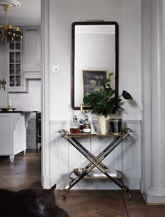 Bar cart / drinks trolley in the calm and collected home of Swedish prop & interiors stylist Joanna Lavén. Photos: Marcus Lawett. Elle Decoration Sweden.: