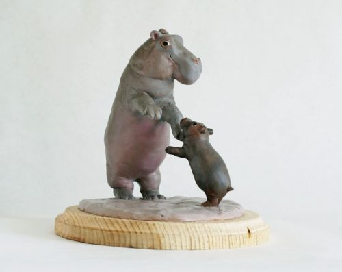"""""""Do Si Do"""" hand-painted polymer clay hippo sculpture by Leslie Sealey.  Of course hippos can dance!"""
