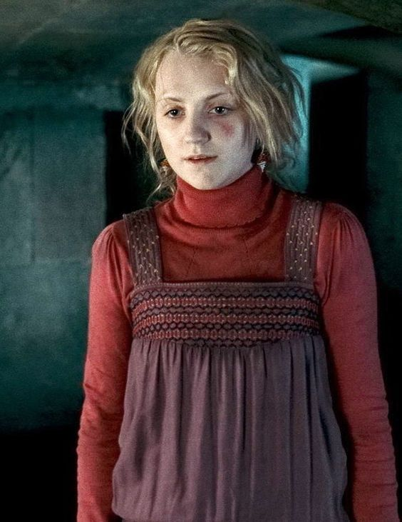Luna Lovegood. I love how all her colorful outfits stand ...