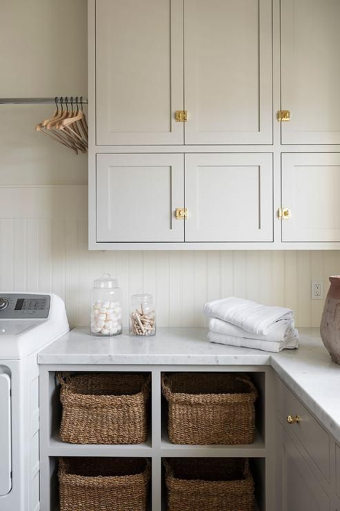Woven Wicker Baskets Perfectly Fitted In Four Open Shelves Under A