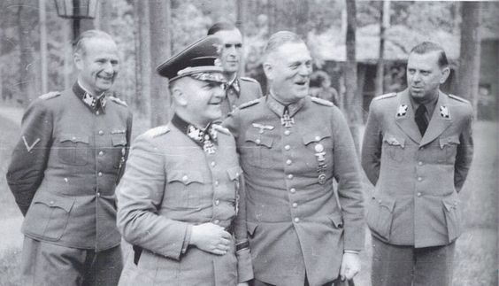 "Totenkopf"" commander SS-Obergruppenführer Theodor Eicke celebrates his award of the Oakleaves with Fieldmarschal Wilhelm Keitel, on the left is Himmler's adjutant Karl Wollf."