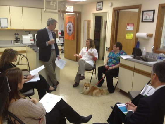 Meeting with Dr. Joanne Carlson and American Veterinary Medical Association representatives at the Loving Care Animal Clinic in Rolling Meadows