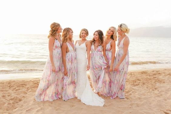 Loving these printed pastel bridesmaid dresses for a beach wedding! Photo by Love and Water Photography