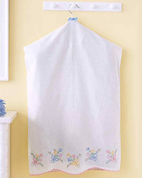 Convert a pretty pillowcase into a garment bag for Easter coats, party suits, or out-of-season clothing. It's wise to store clothes in cloth rather than plastic, since plastic doesn't allow moisture or cleaning chemicals to evaporate.