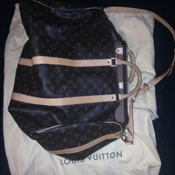 Louis Vuitton keepall 55 duffle travel bag AUTHENTIC Louis Vuitton 4 years old in great condition saw water stains on leather, I'm FIRM HERE. Cheaper other comes with large pull string dust bag, lock (2keys) ID tag, handle strap. This will go to posh concierge for authentication. Louis Vuitton Bags Travel Bags
