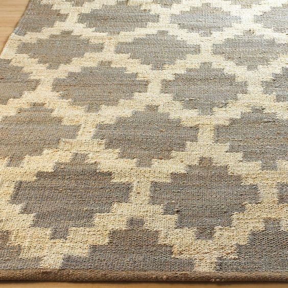 Santa Fe Geometric Chunky Woven Hemp Rug: 2 Colors Natural woven hemp with chunky texture is woven into a classic geometric design taking inspiration from Pueblo Americans and stairstep pattern quilts. Available in Mushroom Gray