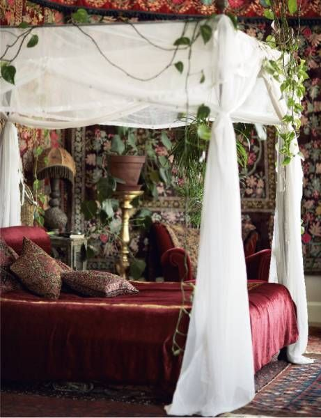 The bohemian princess bed. The white curtains are brightening the wine color of the bed. Love the flowers on the wall too