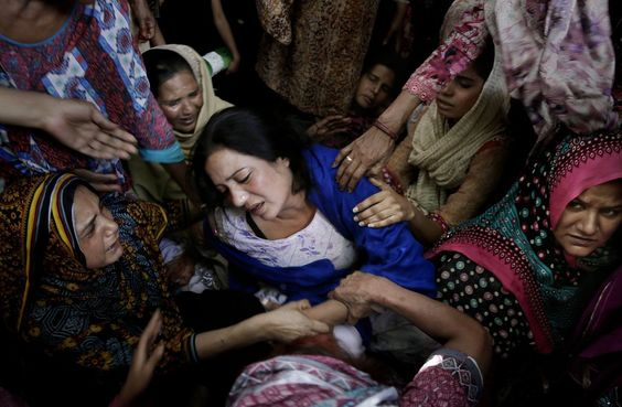 Mourners the day after the attack in Lahore. The bombing targeted Christians in Pakistan.