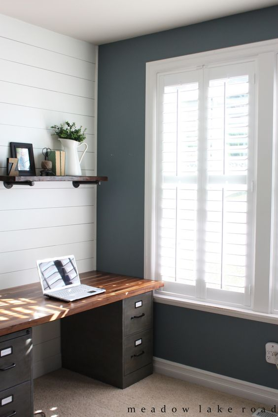 Wood shutters on the windows in our home office to provide privacy while still allowing light in - www.meadowlakeroad.com @blindsdotcom #shutters: