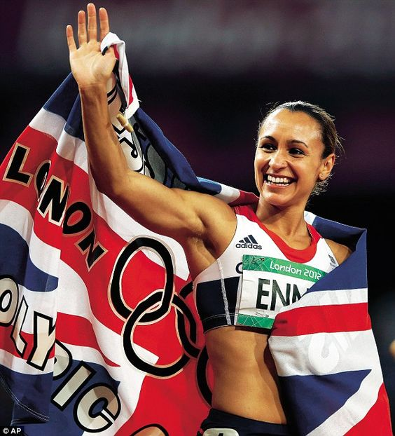 Britain's Jessica Ennis celebrates winning gold following the 800-meter heptathlon during the athletics in the Olympic Stadium at the 2012 Summer Olympics