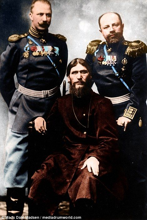 Here he is pictured left with two Russian nobles...