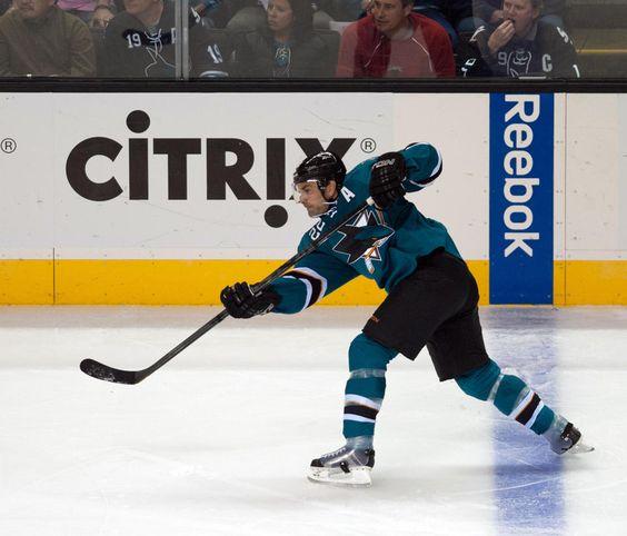 San Jose Sharks defenseman Dan Boyle follows through on his slap shot blast that beat New York Rangers goaltender Henrik Lundqvist for a first period goal (Oct. 8, 2013).