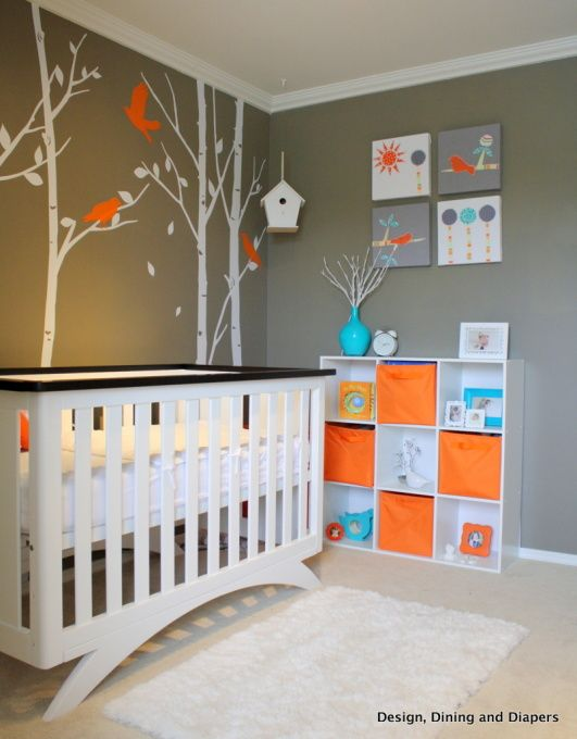 Trees for olivia room. Hadn't thought of orange with gray... this is such a sweet, but bright color combo and could work for a girl or a boy room! I love the crib - how unique! And I love the paintings on the wall!