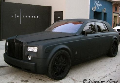 This is so tight!! Rolls Royce with a blk wrap job on blk rims!  THE BLACK OUT ROLLS ROYCE