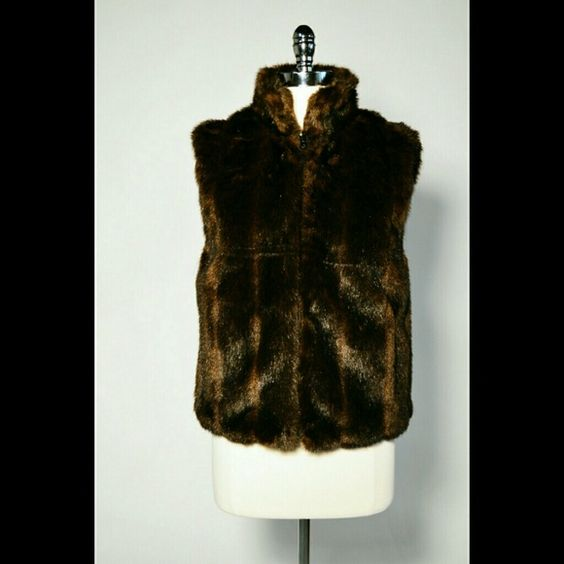 Reversible Faux Fur Vest Reversible  Faux Fur Vest in Chocolate Brown Size Medium  Material Information not available Care Instructions not available 2 interior pockets, 2 exterior pockets Reversible  Condition: New Jackets & Coats Vests