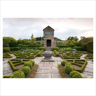 The Fancy Garden at Herterton House, Hartington, Northumberland, UK. Includes a gazebo and a boxwood pattern based on a Tudor rose pattern. Photo by Carole Drake. Via www.gapphotos.com.