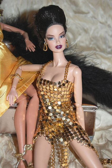 https://flic.kr/p/6nKK6j   20m   This outfit is entirely created from small peaces of golden metal. Is a very sexy dress and it looks nice with the golden earrings and bracelet.