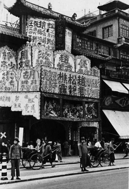 """Shanghai, China, 1930s. You can see the """"coolies"""" carrying people in their rickshaws. Their lives were often worse than death. Very poor and treated like the dregs of society by the the other citizens."""