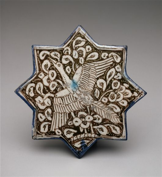 TILE WITH FLYING CRANE (Iranian)  Date     1260/1300 Medium     Composite body with over-glaze luster and in-glaze painted decoration....