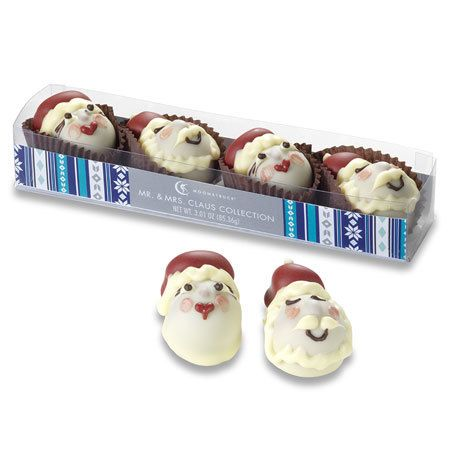 Adorable Mr. & Mrs. Claus truffles from Moonstruck Chocolate. Santa is filled with milk chocolate ganache, & his Mrs. is filled with milk chocolate caramelized hazelnut toffee ganache.