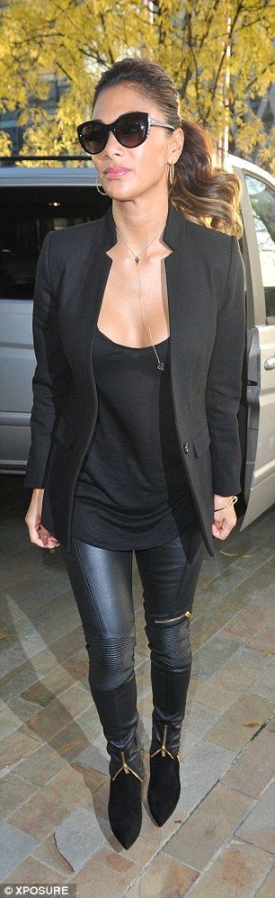 Total knockout! The former Pussycat Dolls star teamed the sexy pair of trousers with a plu...