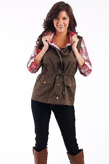 """Top Rank Vest, Army Green $42.00 You will be sorry if you miss out on this vest! It looks great paired with a plaid shirt as you can see, and we love the drawstring waist. Just add boots and out the door you go!    From the shoulder to the hem:  S-25""""  M-26""""  L-26.5"""""""
