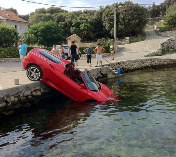 A van's brakes failed, barging a Ferrari into the sea. The bright red Ferrari 360 Spider was parked at the edge of the harbour while its owner was eating at a restaurant just ten metres away.  He then watched helplessly as a white Renault Master truck crashed into the back of his 185mph convertible, pushing it over the edge and into the water. The incident was captured on the Croatian island of Pag in the Mediterranean sea by Tibor Szirovicza.