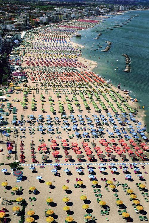 Rows of umbrellas in Rimini, Italy.