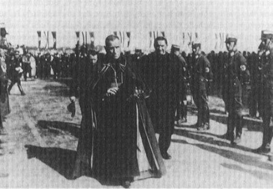 An Archbishop with the Nazis  Archbishop Cesare Orsenigo, head of the Diplomatic Corps, attending the Nuremburg Party Rally in September 1933.  According to Dr. Paul O'Shea, Orsenigo, as Dean of the Corps, it was the Nuncio's role to lead the Corps at all major government functions. After 1935 Orsenigo did not attend major government propaganda displays.