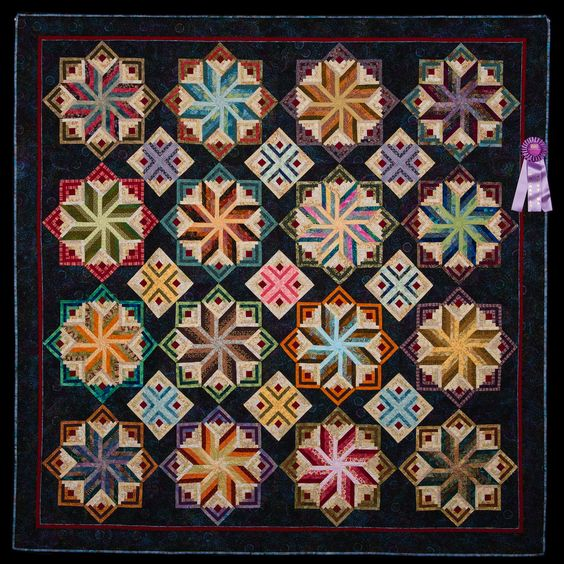 2012 Quilt Expo Quilt Contest, Honorable Mention, Category 3, Machine Quilted Bed Size Pieced: Logs and Stars in Scraps, Leslie Kiger, Saint Simons Island, Ga.
