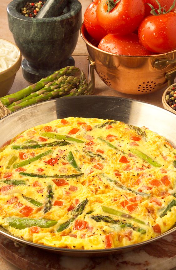 This Asparagus Frittata has fresh asparagus, Swiss cheese and fresh tomatoes adorn this open-face omelet.