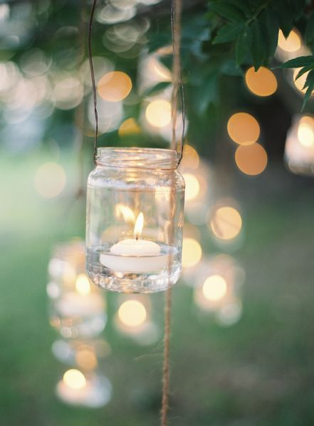 Tealights in a Mason jar suspended w/ wire and twine