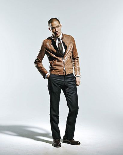 Dig the juxtaposition of the rugged leather jacket and the sleek