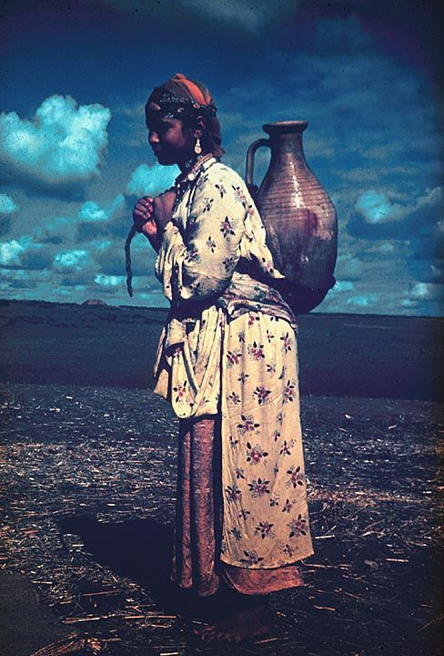 Berber Woman in Moroccan Village Carrying Water.  North Africa  © Africa Focus: University of Wisconsin