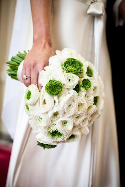 A full bouquet of white and green ranunculus with an ivory ribbon and raw twine by Anemone.