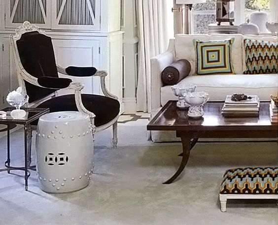 could definitely see a chinese garden stool as an accent table in your space.  White might be nice